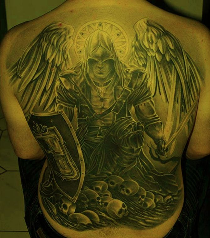 Awesome warrior angel in armor tattoo on whole back for Warrior angel tattoos